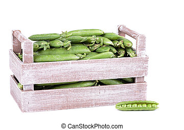 peas in a wooden bo