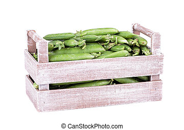peas in a wooden box