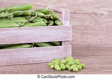 peas in wooden box