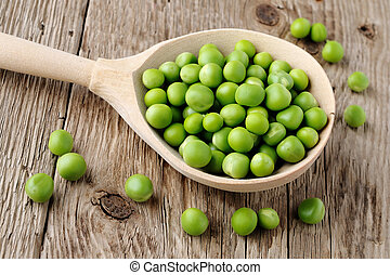Peas in wooden spoon