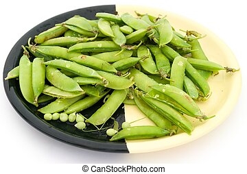 Peas pods on a plate