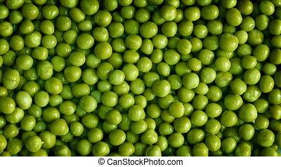 Peas Rotating - Overhead shot of green peas turning slowly