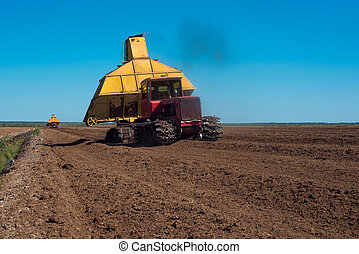 Special machine for peat extraction. Peat harvester. Agriculture industry, peat farm