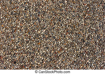 Texture of pebbles in an exposed aggregate foundation