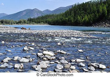 Pebble Bank of a mountain river. Russia, Yakutia, A Ridge Of...