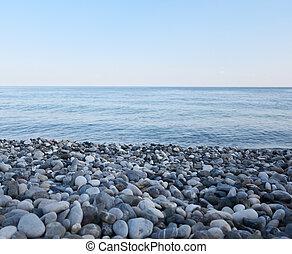 Pebble beach and blue sea