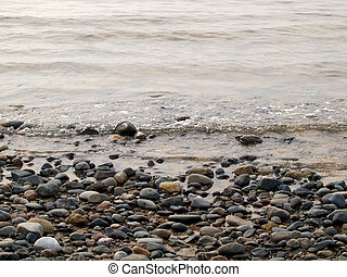 Pebble beach and sea shore