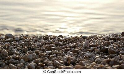 Pebble beach and sea - Pebble beach and calm sea background