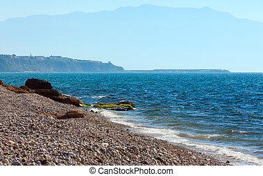 Pebble beach and Tyrrhenian Sea coastline, Sicily.