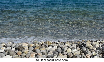 Pebble Beach - Beautiful azure blue sea and pebble beach on...