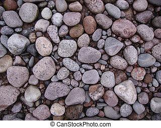 Pebble beach from varicoloured stone