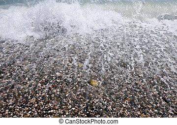 Pebble beach - Sea wave on a pebble beach
