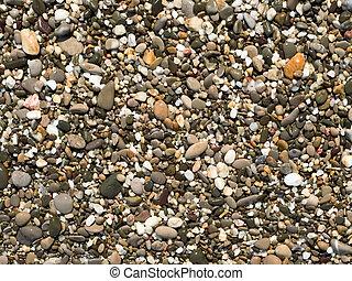 pebble beach smooth stones background.