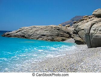 Pebble Beach - Waves crash on white pebble beach