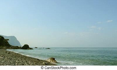 Pebble beach, waves, rocks and moun - Sea coast with pebble...