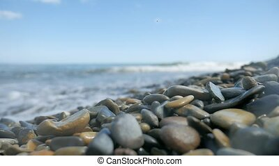 Pebble beach waves sea. Stone beach ocean the sea waves...