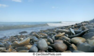 Pebble beach waves sea. Stone nature beach ocean the sea...