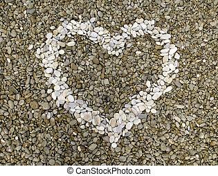 Pebble heart on the beach.