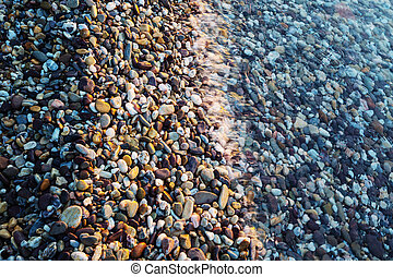 Pebble - pebble on the sunrise beach