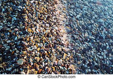 Pebble - pebble on the sunrise beach