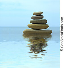 Pebble stack reflecting in the water