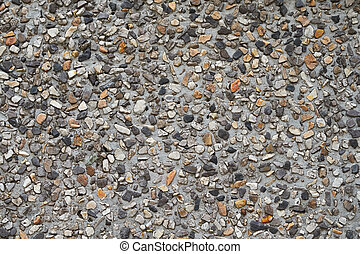pebble stones in a concrete wall texture
