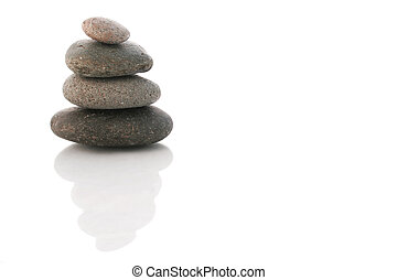 Stack of pebbles over white with reflection