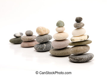 pebbles forming graph on white background