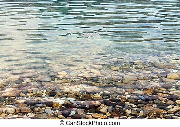 Pebbles in the clear water