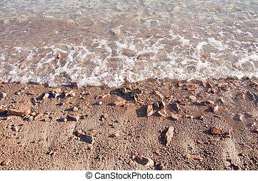 pebbles on beach sea wave