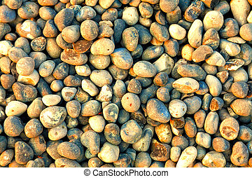 Pebbles on the beach as background