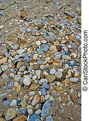 Pebbles on the beach sand