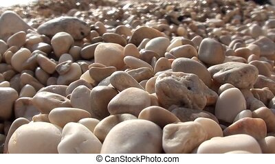 Pebbles on the beach - Wet and dry pebbles on the beach,...