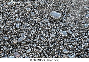 Pebbles on the black sand beach