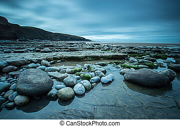 Pebbles on the Shore at Dunraven Bay
