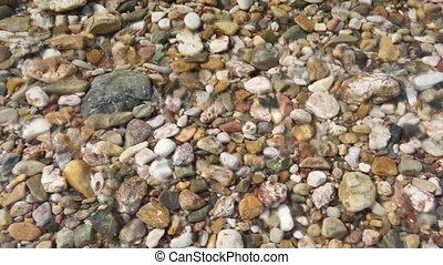 Pebbles on the sunny beach