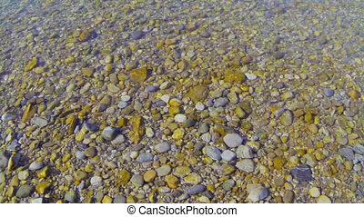 pebbles - Pebbles in the water at a river bank.