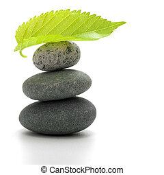 pebbles pile and a leaf isolated over a white background