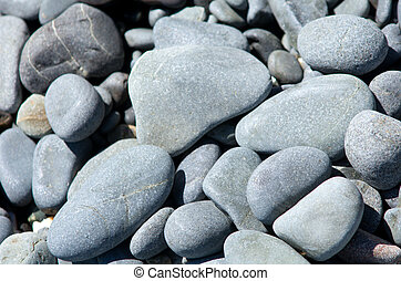 Pebbles stones on the beach. background image.