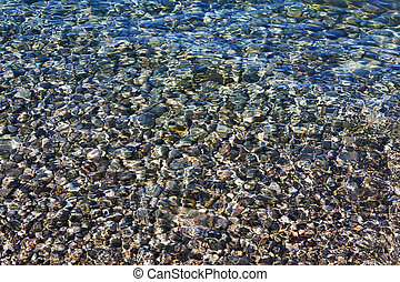 pebbles under the clear sea water