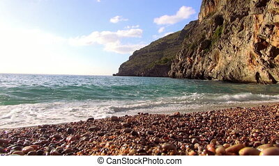 Pebbly beach at a rocky coast