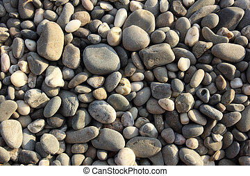 pebbly gray beach stones abstract texture background