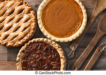 Pecan Apple and Pumpkin Pies - Overhead view of three pies ...