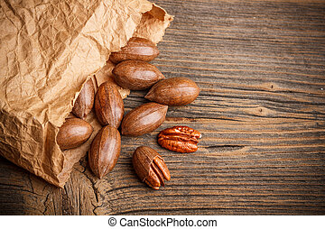 Pecan nut - Organic fresh harvested pecan nut in paper sack