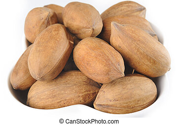Pecan nuts in white bowl