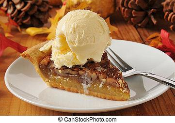 Pecan pie a la mode - a slice of pecan pie with vanilla ice...