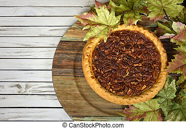 pecan pie with maple leaves
