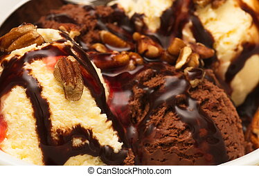 Pecans on a Chocolate and Vanilla Sundae - A chocolate and...