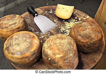 Pecorino cheese on wooden table. - Small wheels of pecorino ...