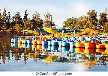 Pedal Boats for Rent in Lake at Park - Row of colorful pedal...